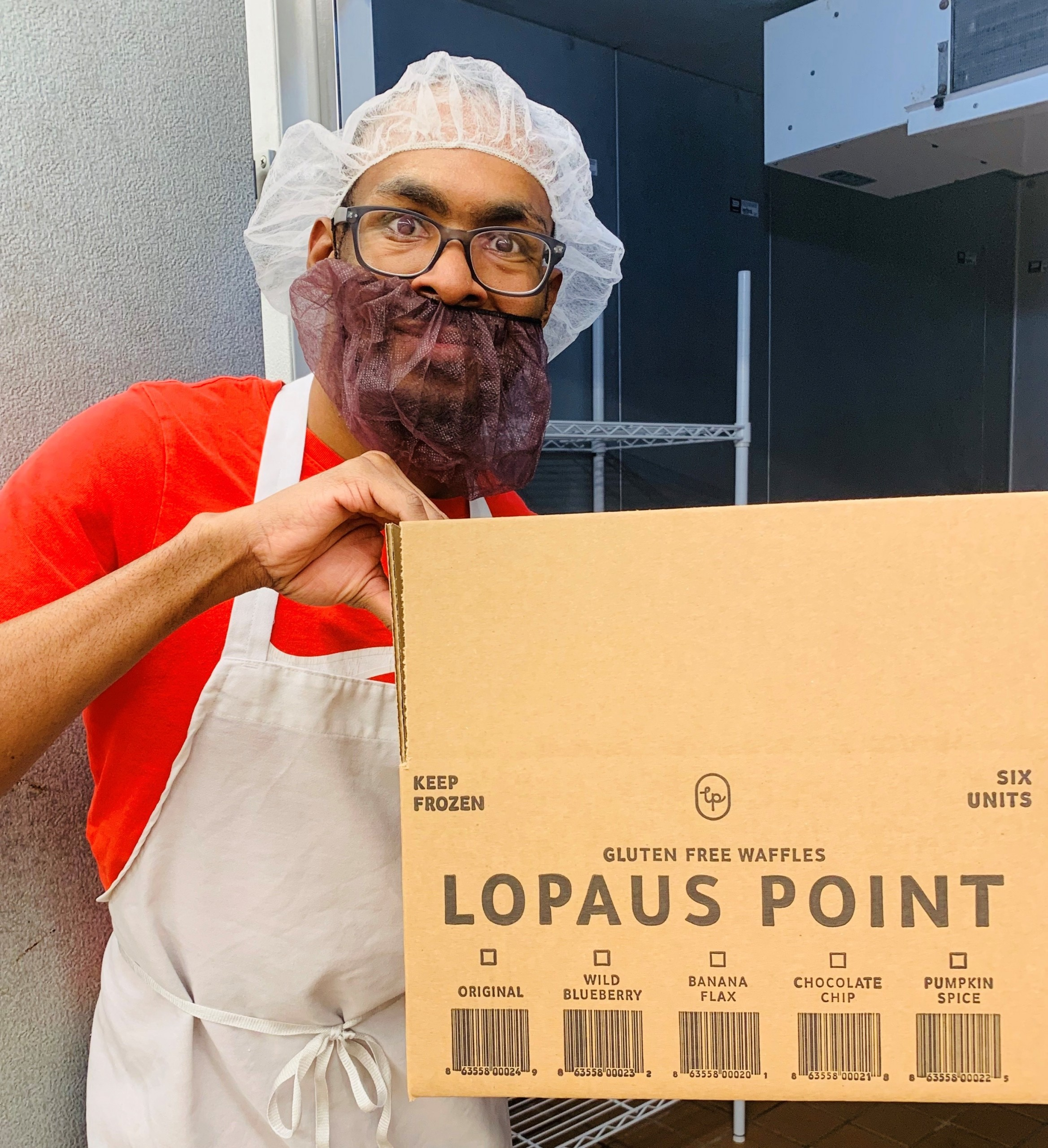 Brandon fills a box with Lopaus Point waffles