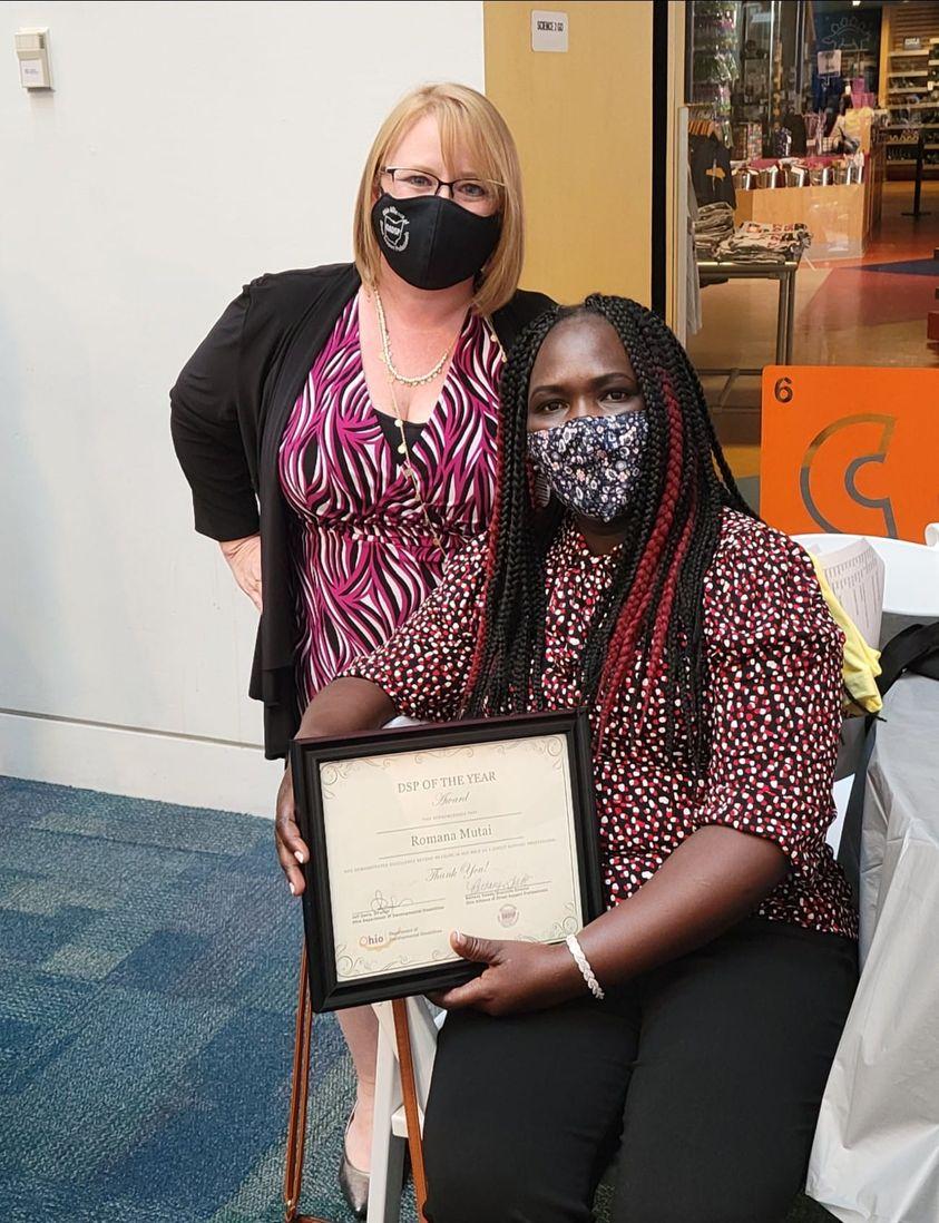 Romana Mutai holding award next to Bethany Toledo